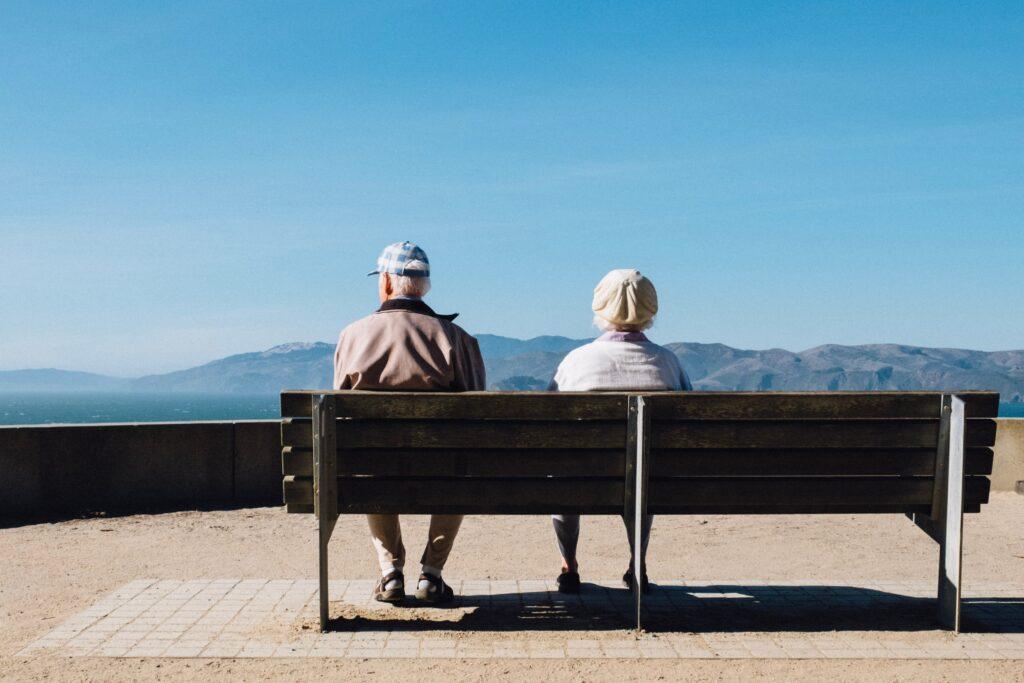 Senior couple relaxing at ocean