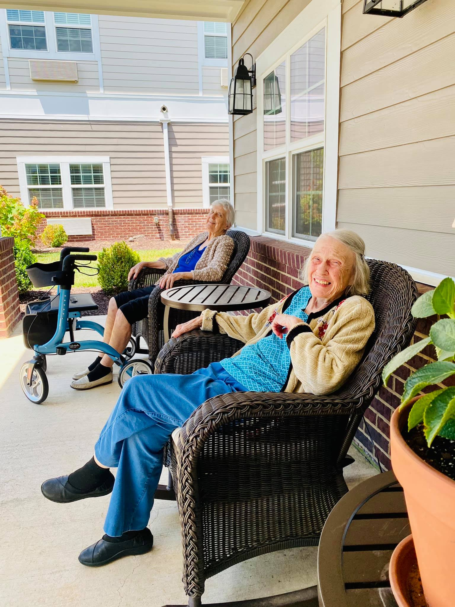 two women sitting on the patio outside at Traditions of Spring Hill